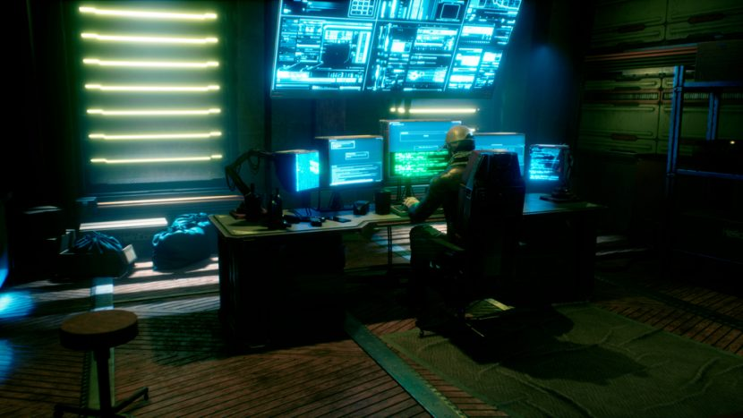 A male hacker surrounded by glowing monitors hacks into someone else's computer network in a dark room of his office